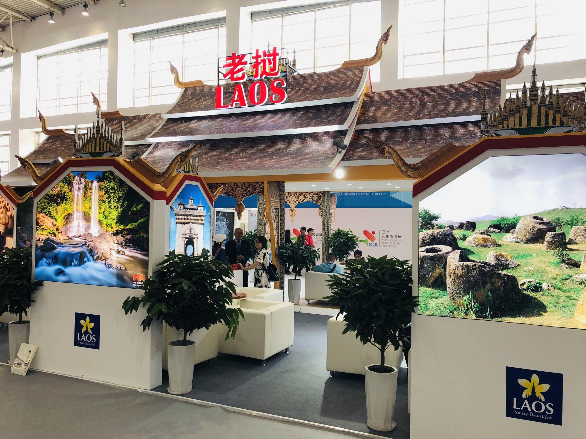 """图为亚洲文明对话大会""""亚洲文化旅游展""""老挝展馆"""