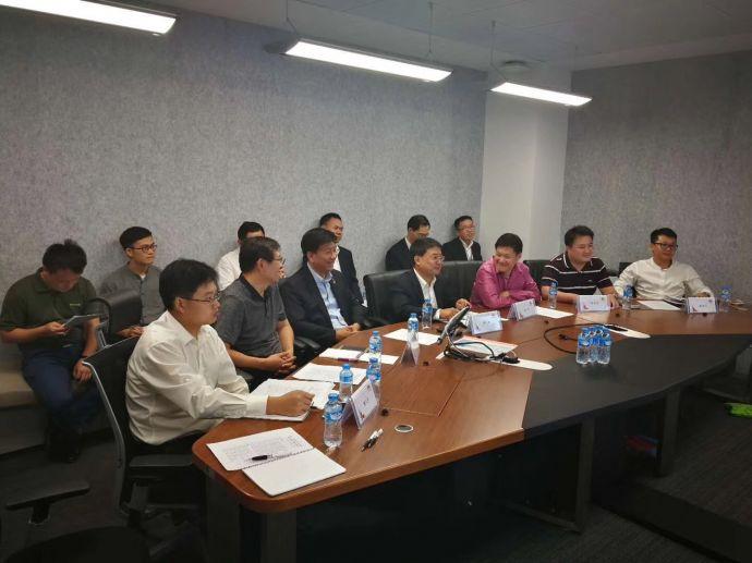 """这是首届""""一带一路""""老-中合作论坛筹备小组第一次会议华为老挝公司智真会议室现场。 华为老挝公司 杨梁摄"""
