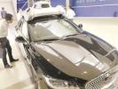 """18日,在上海举行的世界智能网联汽车大会期间,上海连续打出多项智能网联汽车领域的""""组合拳"""",向世界级汽车产业中心发力。"""