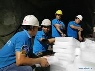 Chinese workers overcome harsh conditions for China-Laos connectivity project