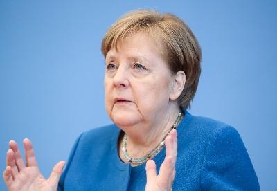 默克尔说德国全力支持世卫组织国际合作倡议